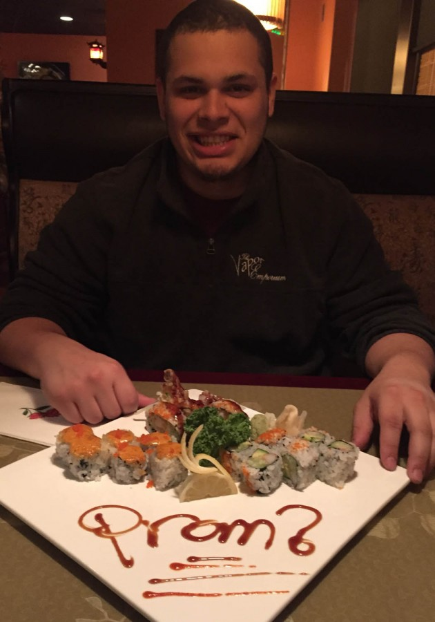 Linganore graduate Kyle Speck enjoys a plate of sushi after his girlfriend promposed to him at Katana.