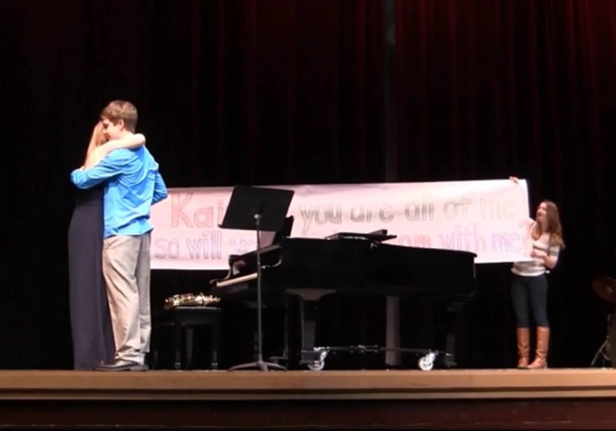 Brandon Kleinmann promposes to his girlfriend, Kaitlin Byrnes, on stage at the Mr Linganore competition on March 8.