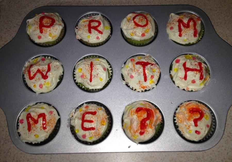 Jordan Mclain presents her boyfriend Kyle Thompson with a pan of cupcakes asking him to prom.