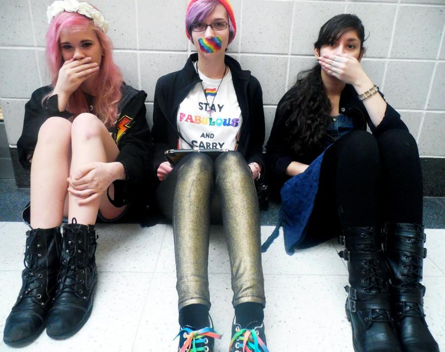 Students (From left to right) Erica Houck, Gracie Williams, and Rozmia Fattah stay silent for the national Day of Silence