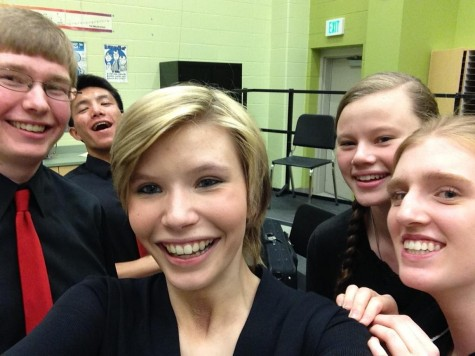 Band students snap a selfie after their performance