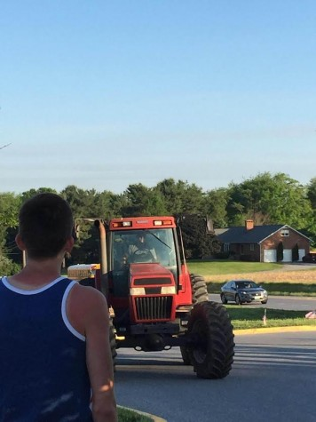 Seniors stage parking lot stunts: Photo of the Day 5/26/2015