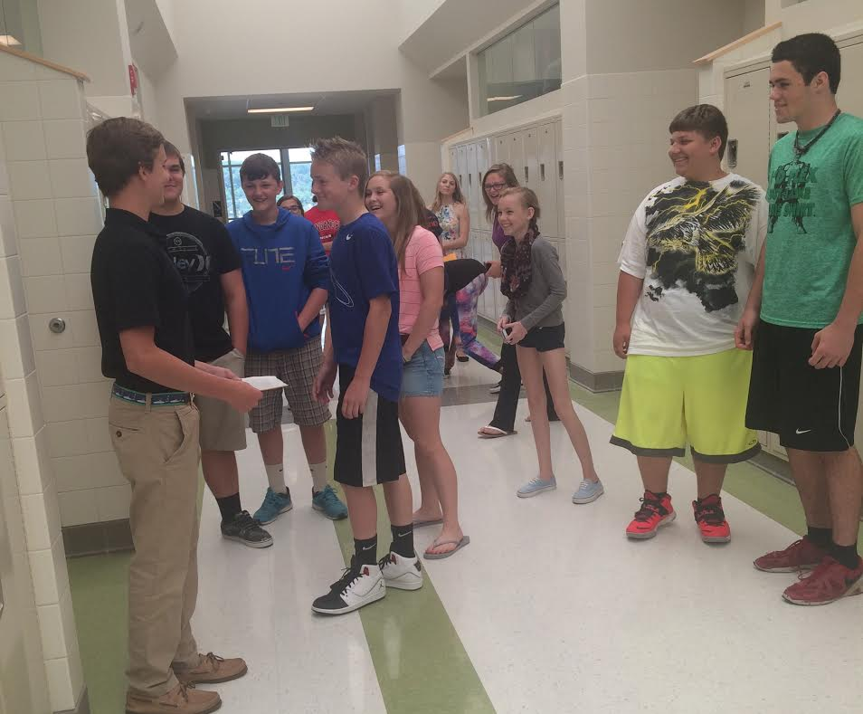 SGA Vice President Hank Beiter gives a tour to a group of 8th graders from NMMS.