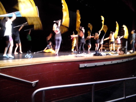 Color guard practices for another win in marching band competitions: Photo of the Day 9/29/15