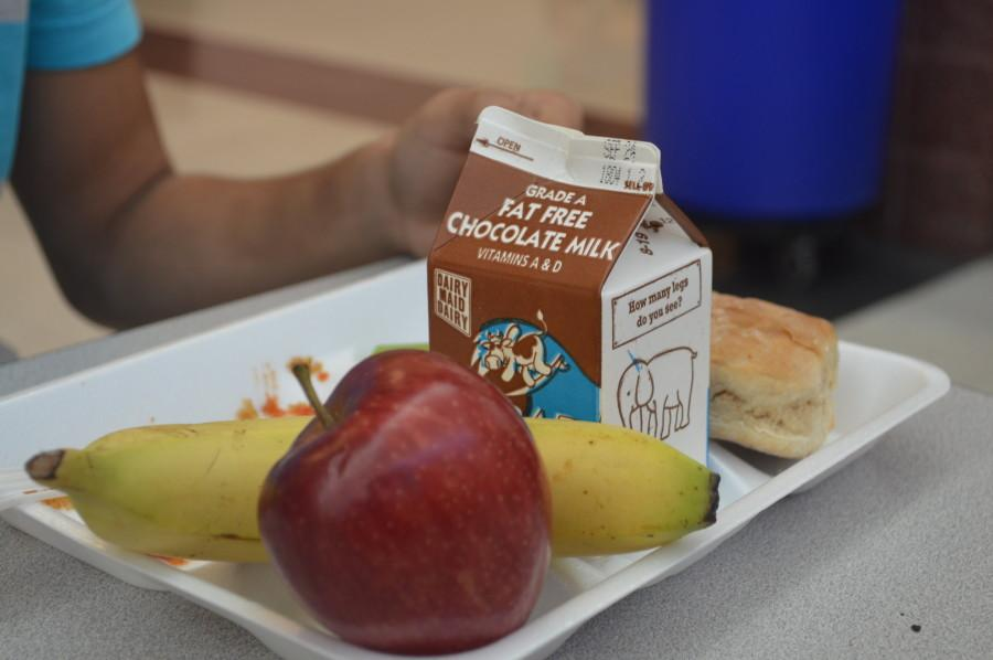 Freshman Kevin Figueroa sits down for his daily cafeteria lunch