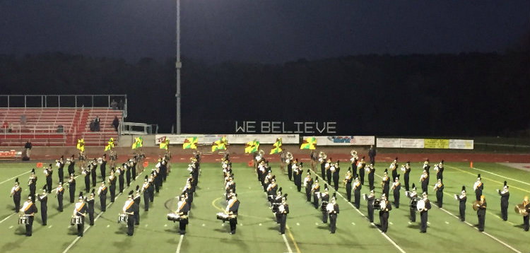 The+marching+band+and+color+guard+performs+at+the+homecoming+game.
