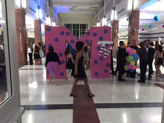 The MTV sign was a center attraction at the Homecoming Dance. Maleeha Coleburn is seen walking in front of it.