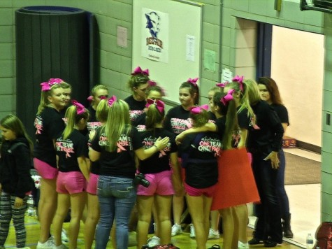 JV cheer squad waiting to take the floor to compete