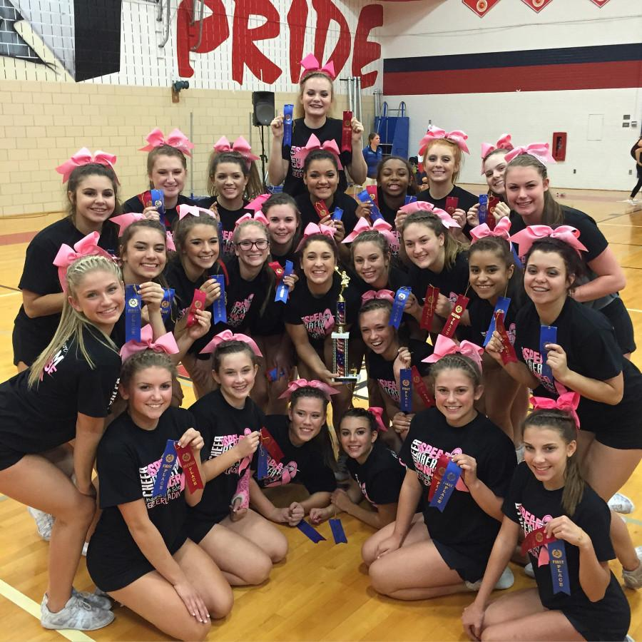 The varsity cheerleaders posing for a picture after winning their first competition of the season.