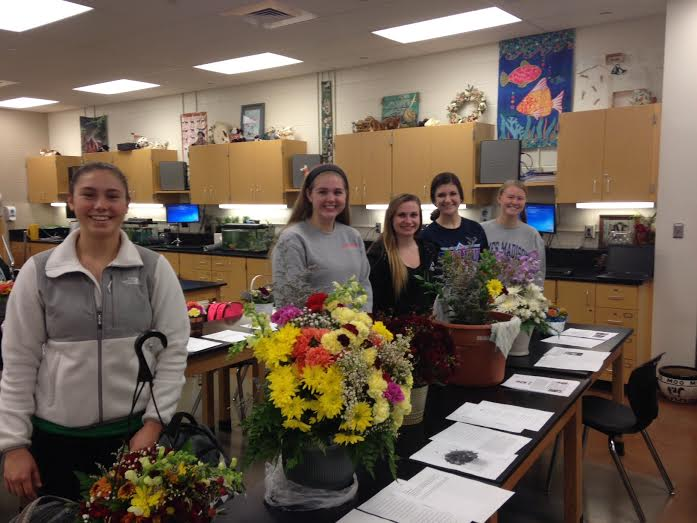 Horticulture students show off their arrangements.