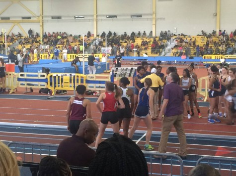 The girls team prepares to race in the 2x400.