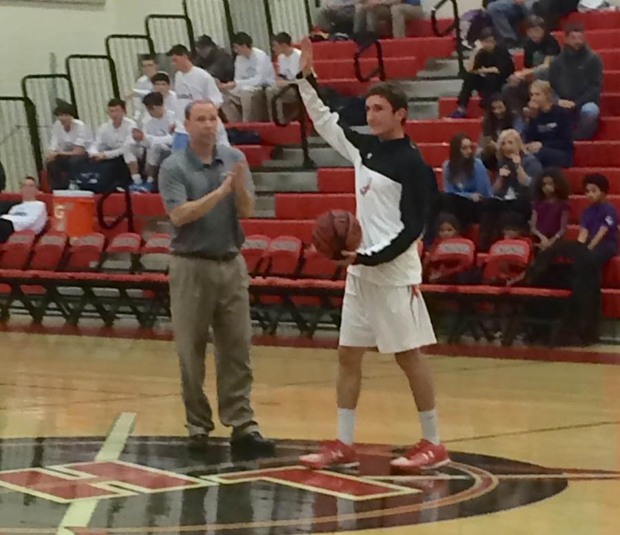 Senior Thomas Lang is recognized before game next to Coach Tom Kraft.
