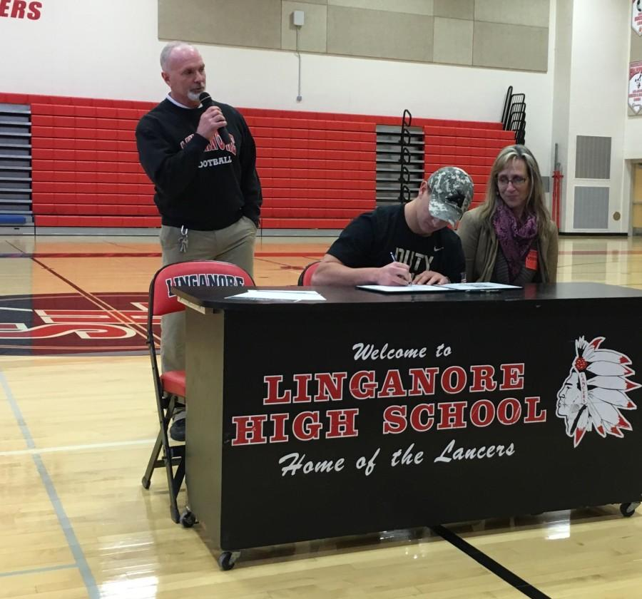 Daniel Ross signs his letter of intent to play lacrosse at West Point.