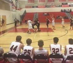 Sophomore Joe Kolick makes a clutch free throw shot, as his teammates cheer him on.