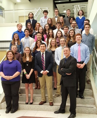 New inductees, society advisers, and Rho Kappa officers pose for a group photo after the annual induction ceremony.