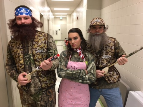 Tyler Fleagle, Elizabeth Coletti and Nathaniel Musselman pose before the show in their Duck Dynasty gear.