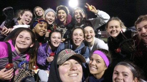 The Varsity Lacrosse team takes a selfie after a long days work.