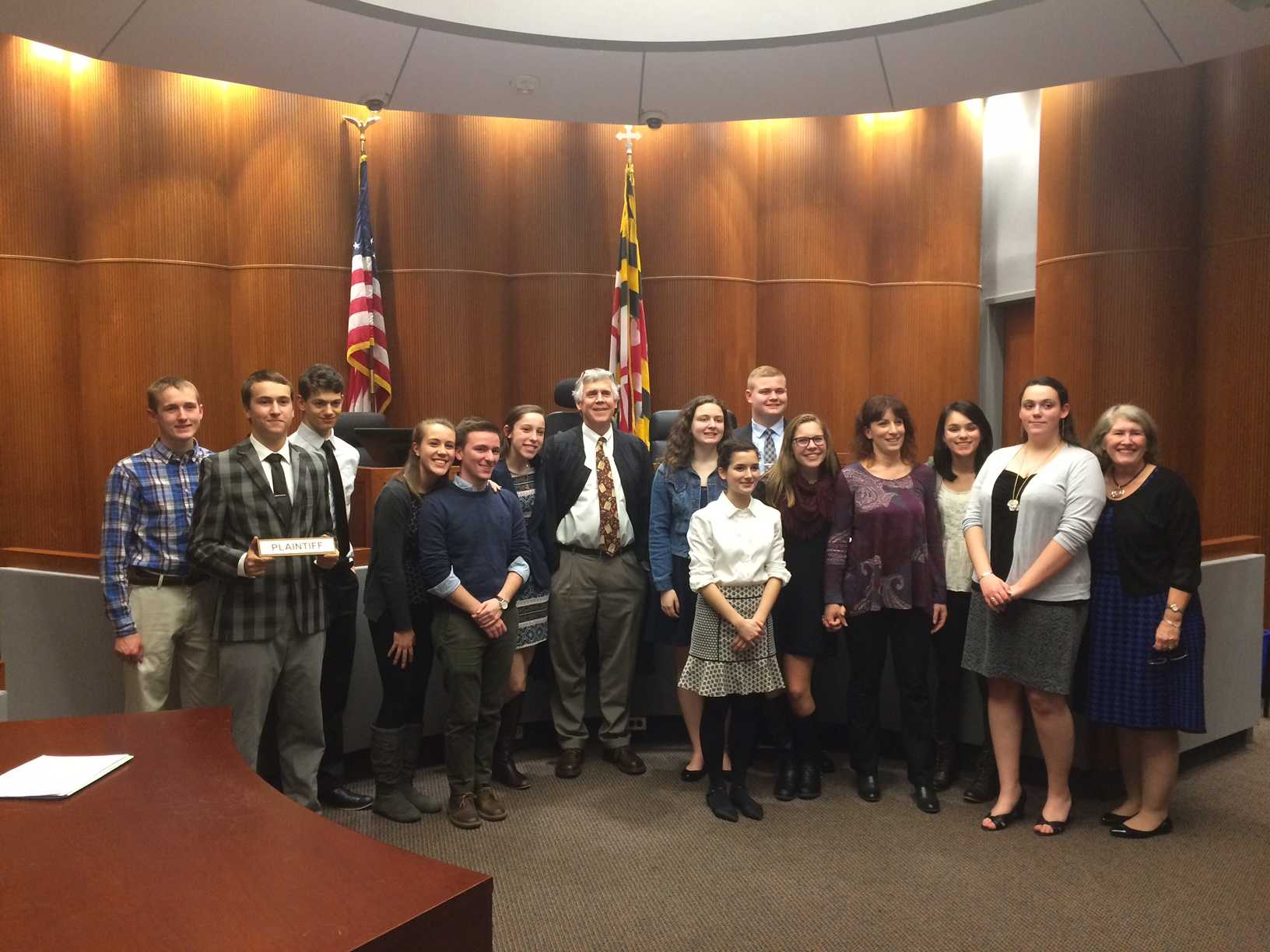 The Mock Trial team poses with their judge after the competition.