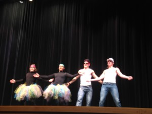 (From left to right) Steiren, Ross, Musselman, and Stores dance together.