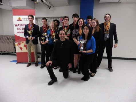 The victorious World Scholar's team posing for a photo with their awards. (Left to right) JD Ensor, Dalton Monague, Samantha Buckman, Maleeha Coleburn, Richard Zhang, Seth Roberts, Brendan McCann, Garrett Wiehler, Laura Glawe, Burke Roberts, Hugh Norko, Emily Barbagallo, and Kasal Smaha.