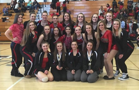 The LHS Pom and Dance team poses after a successful first competition at Urbana High School.
