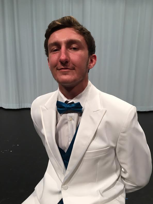 Lang poses in his white Men's Warehouse tuxedo.