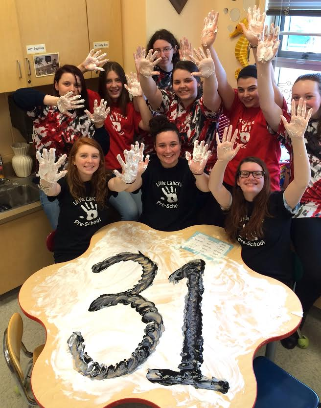 Child Development two and three seniors create the number 31 with a popular sensory lesson, shaving cream and paint.  (Back L to R) Renee Galtieri, Alyssa Mattison, Megan Gagne, Brittany Reid, Lauren Thompson, Jazlyn Hyde. (Front L to R) Aubrey Naill, Laura Glawe, Kaycee Oland.