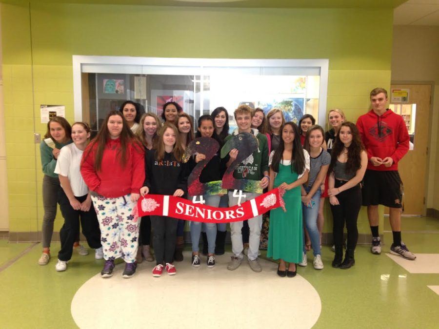 Seniors from the National Art Honors Society celebrate 22 days left with the painting of two flamingos and a senior banner.