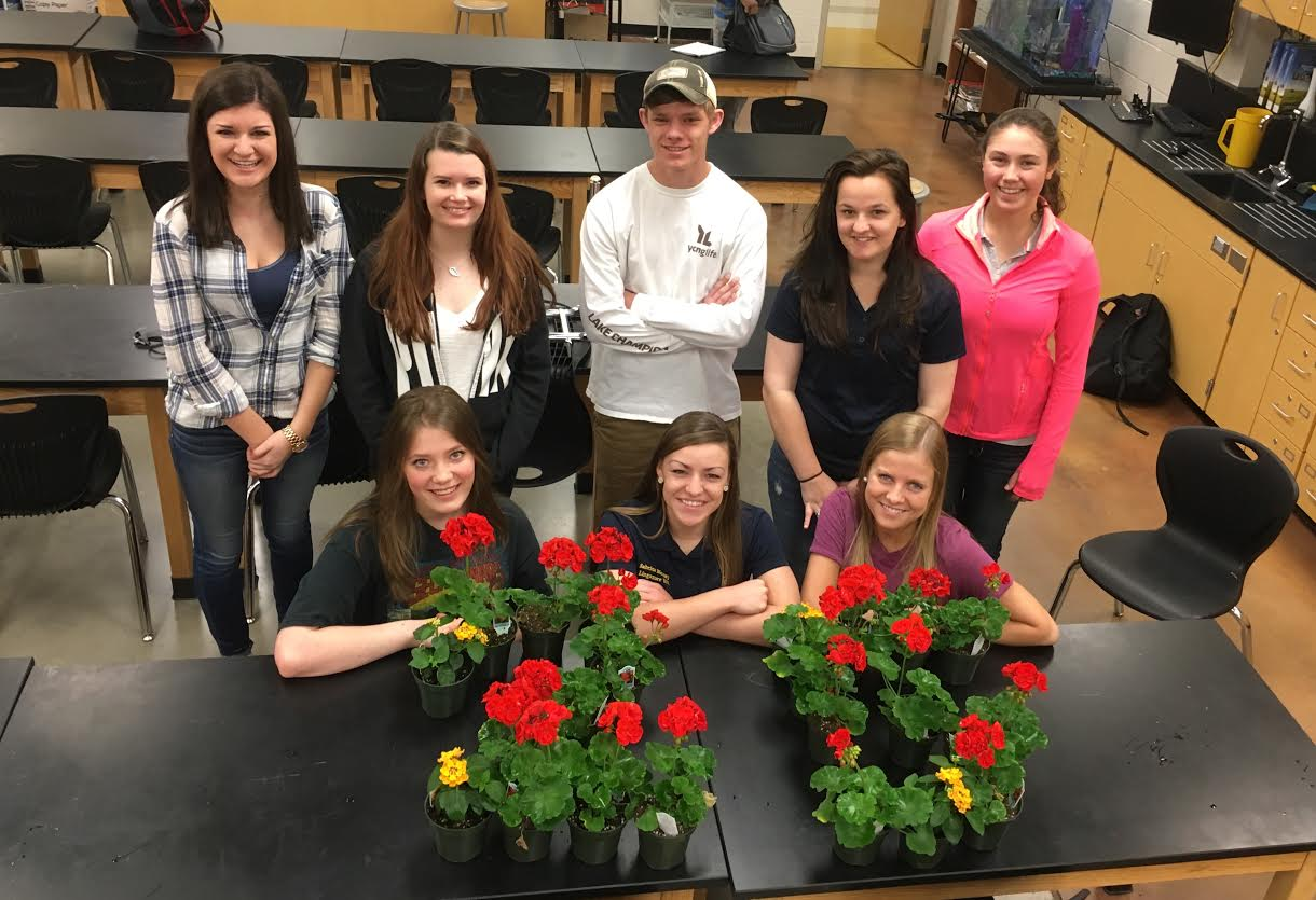 (top left to right) seniors Ashley Abuelhawa, Kaycee Oland, Casey Thompson, Kasey Carns, Delaney Wagner (bottom left to right) Alyssa Mattison, Sabrina Moxely, and Megan Brown celebrate 25 days with flowers.