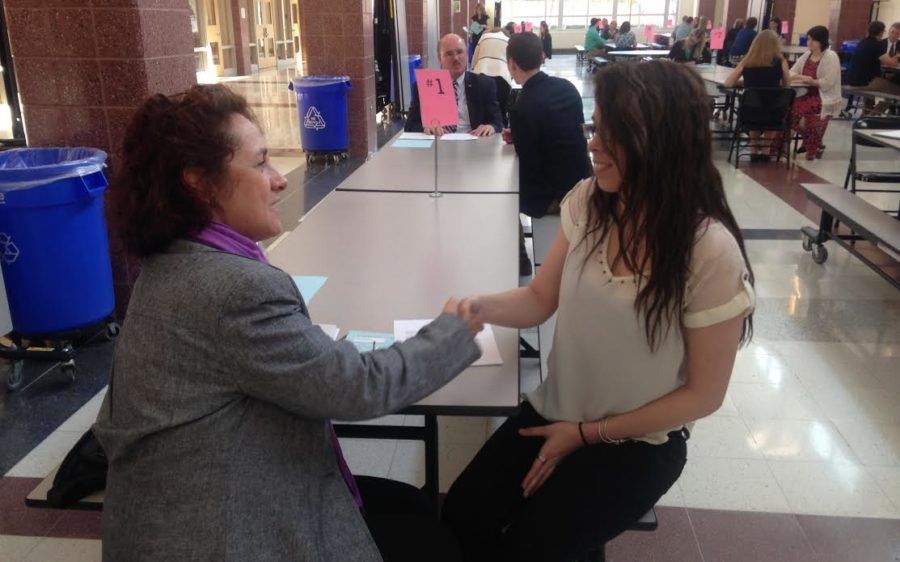 Julie Hoover, a Financial Education Specialist for families, volunteers to interview junior Madison Smith.