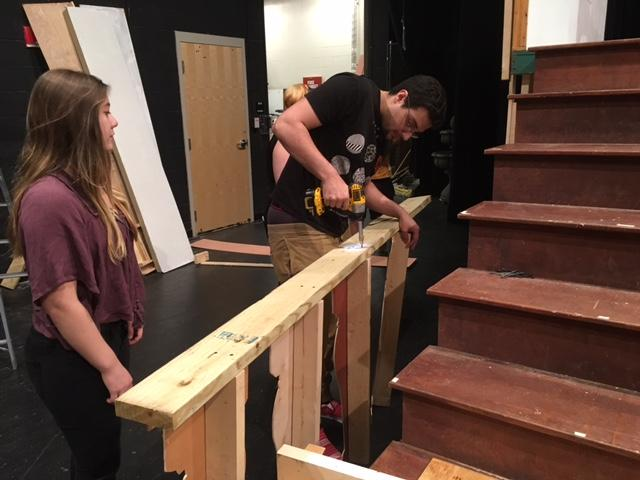 Theatre students build a railing for the set of The Sound of Music.