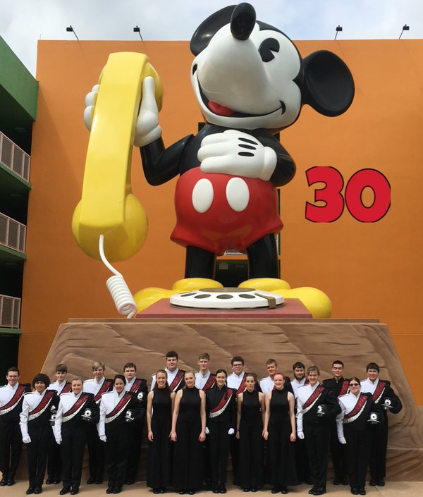 Senior band and color guard members pose for a group shot during their Spring Break 2016 trip to Disney World.