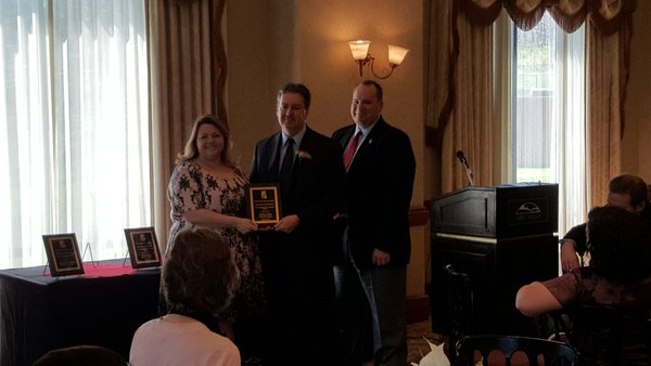 Lloyd receives his award from the Maryland Music Educators Association.