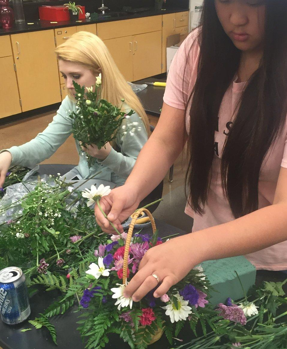 Horticulture students Emily Cavell and Martina Soaper create bouquets for Mother's Day.