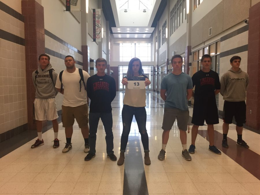(From left to right) Seniors Thomas Lang, Michael McDonald, Will Nixon, Kayla Harner, Tyler Peigh, Brennan Henyon, and Brandon Sapp celebrate 13 days left of school. (Not Pictured Sabrina Moxley, Jack Wilkerson, and Tyler Fleagle)