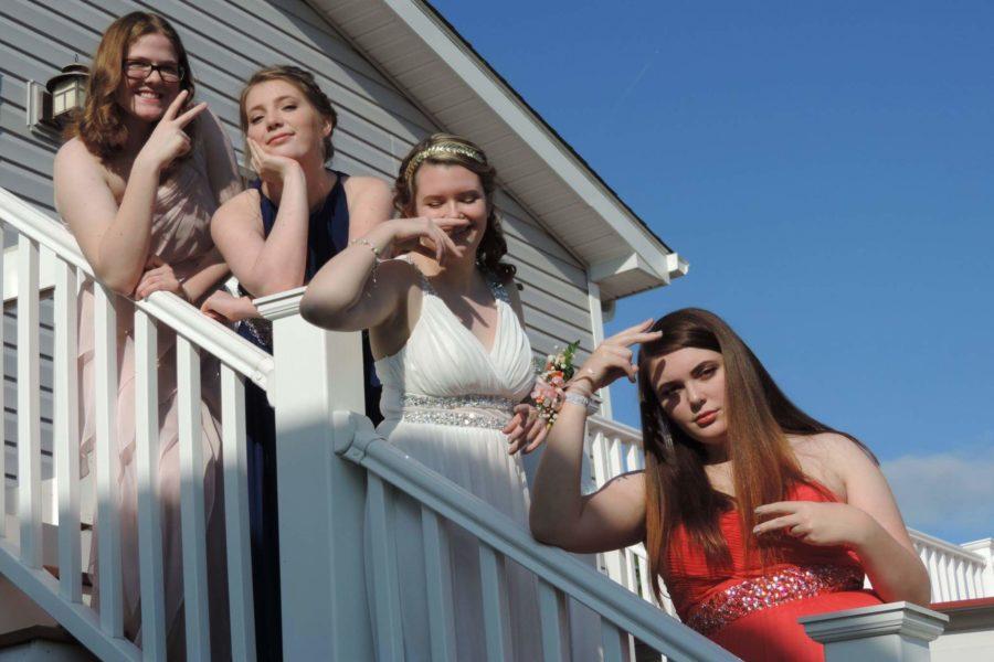 Seniors Emily Gorham, Alyssa Mattison, Kaycee Oland, and Sara Combs pose for the camera before attending prom.