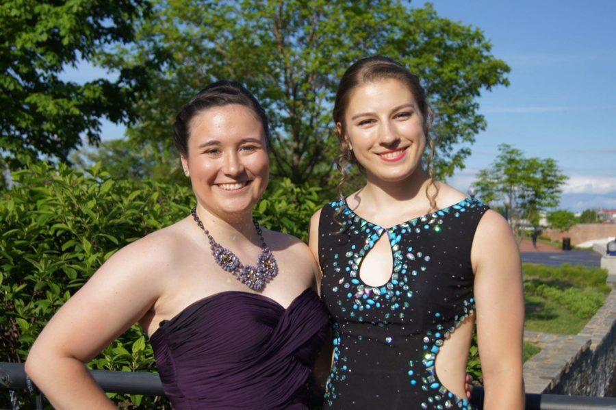 Seniors Laura Glawe and Emma Roerty smile for the camera before prom.