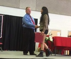 Colleen Avila receives the platinum award for maintaining a 4.0 GPA through out all of high school.