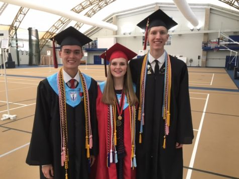 Student speaker, Noah Ismael, and duet singers, Abby Weinel and Kylan Connolly, pose for a picture before graduation.