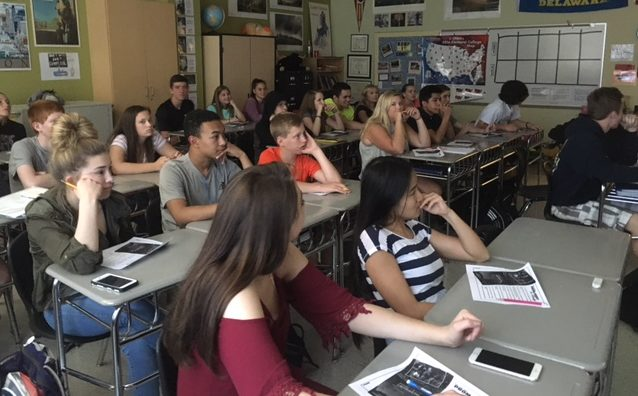 Ms. Hendi's government class watches a movie educating the students  about the dangers of racism.