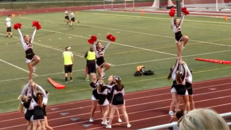JV cheer stunts during the game against Middletown.