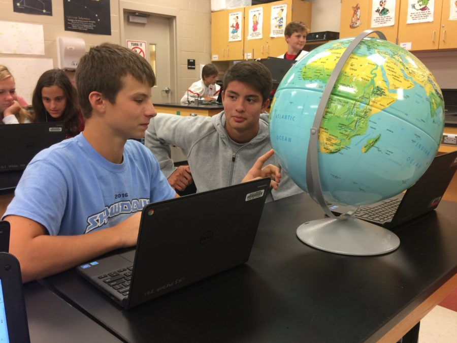 Andrew Martin (left) and Johan Samayoa (right) study the Earth together in Mrs. McCauley's fourth period PES class.