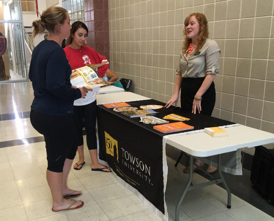Lauryn and Mackenzie talking to the Towson representative.