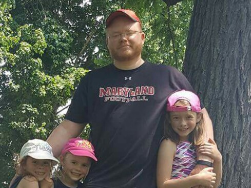 Mr. Bittner enjoying time spent with his three daughters.