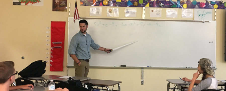 Conte uses his light saber to keep his class entertained while learning.