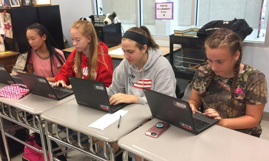 Grace Gaydosh, Mckensi Sensibaugh, Emma France and Devin Wynne work on an English project on their chromebooks.