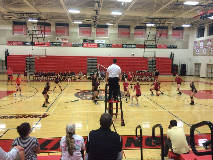 Varsity volleyball team takes on Winters Mill in the final set.