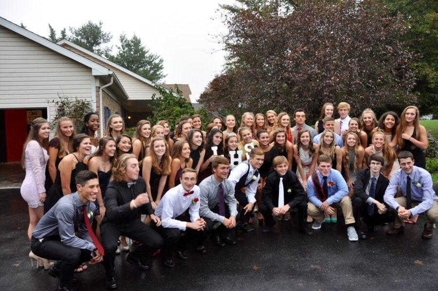 Members+of+the+class+of+2018+pose+before+the+homecoming+dance.