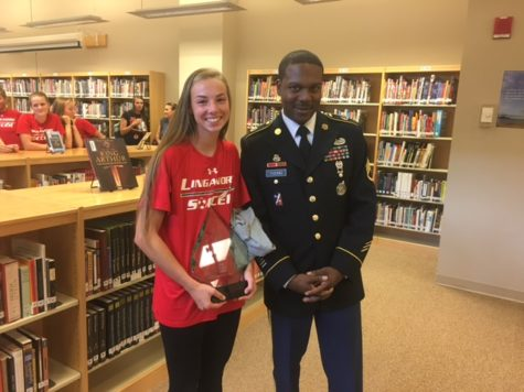 Miranda Keaton receives award from Officer Young
