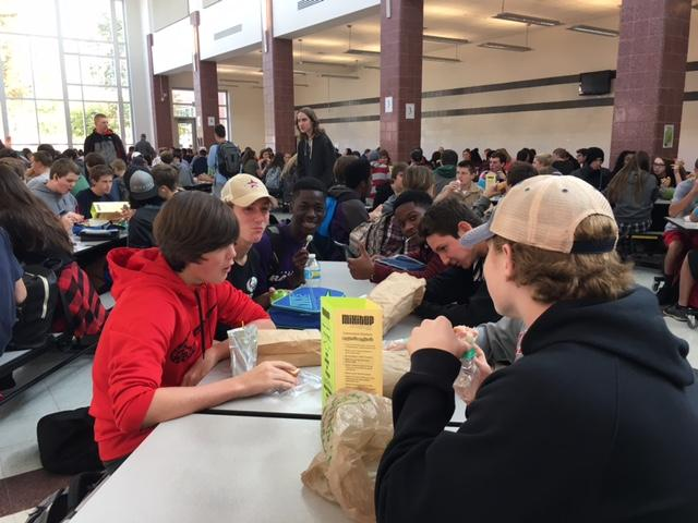 Class of 2020 students, Aidan Shaw and Kojo Benefo mix it up and sit with class of 2019 student, Jon Wheat and class of 2018 student, Devin Barge.